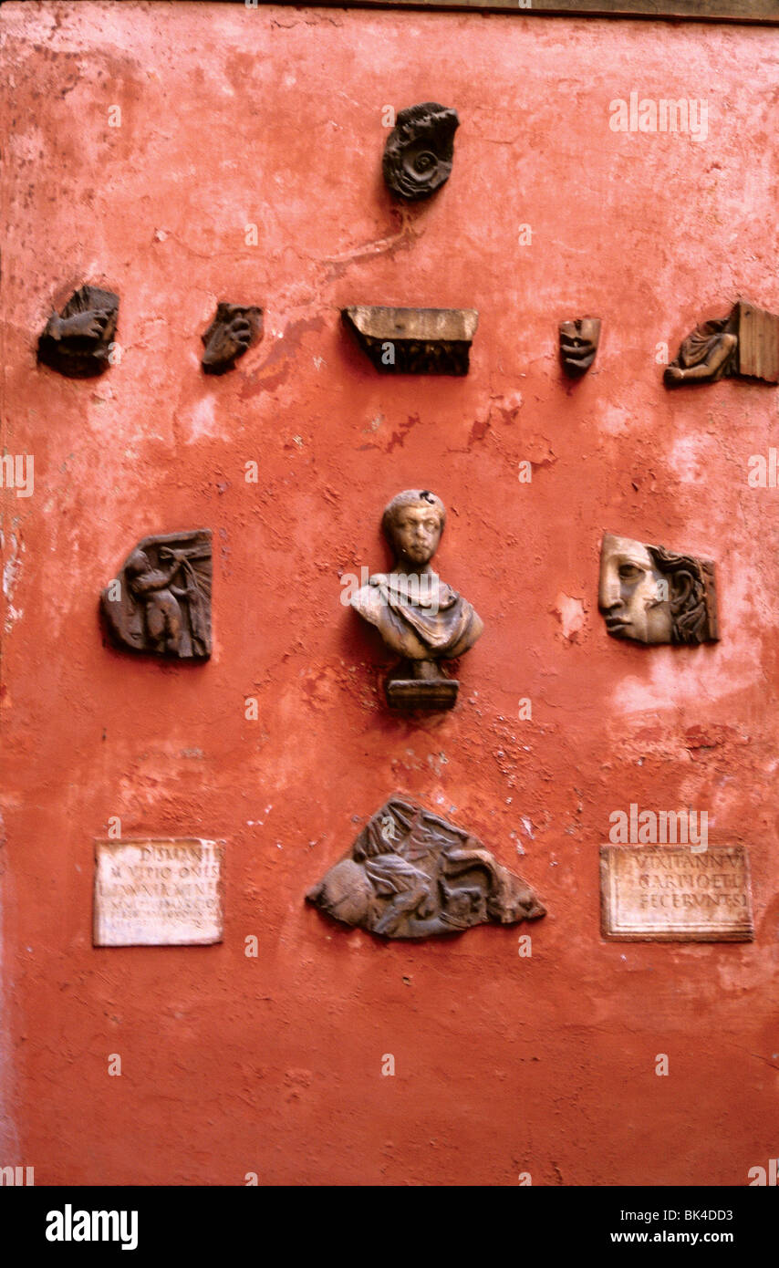 Sculptural artifacts embedded in a wall, Rome, Italy 1988 - Stock Image
