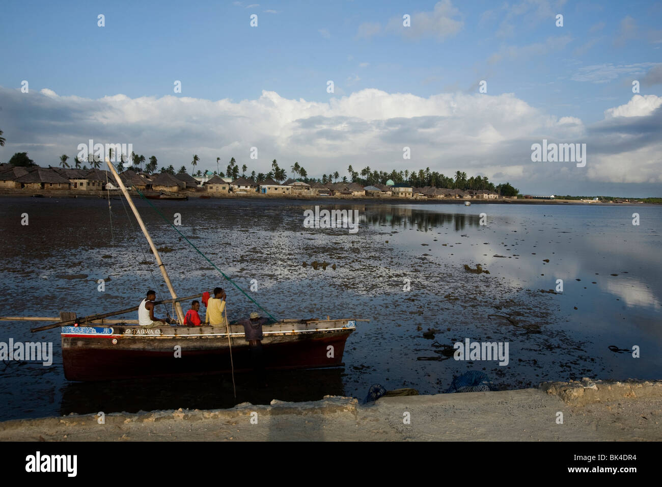 A sailing dhow on a low tide beach in the village of Kizingitini, Pate island on October 1, 2009 in the Lamu archipelago, - Stock Image