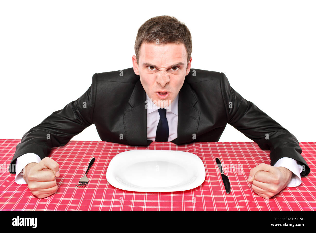 An angry man waiting his food in a restaurant - Stock Image