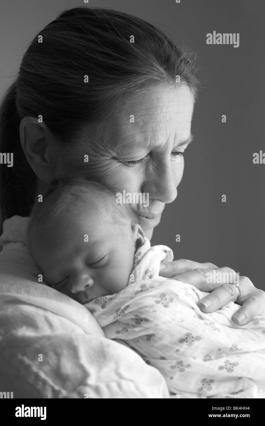 Grandma with her Granddaughter at three days old. - Stock Image