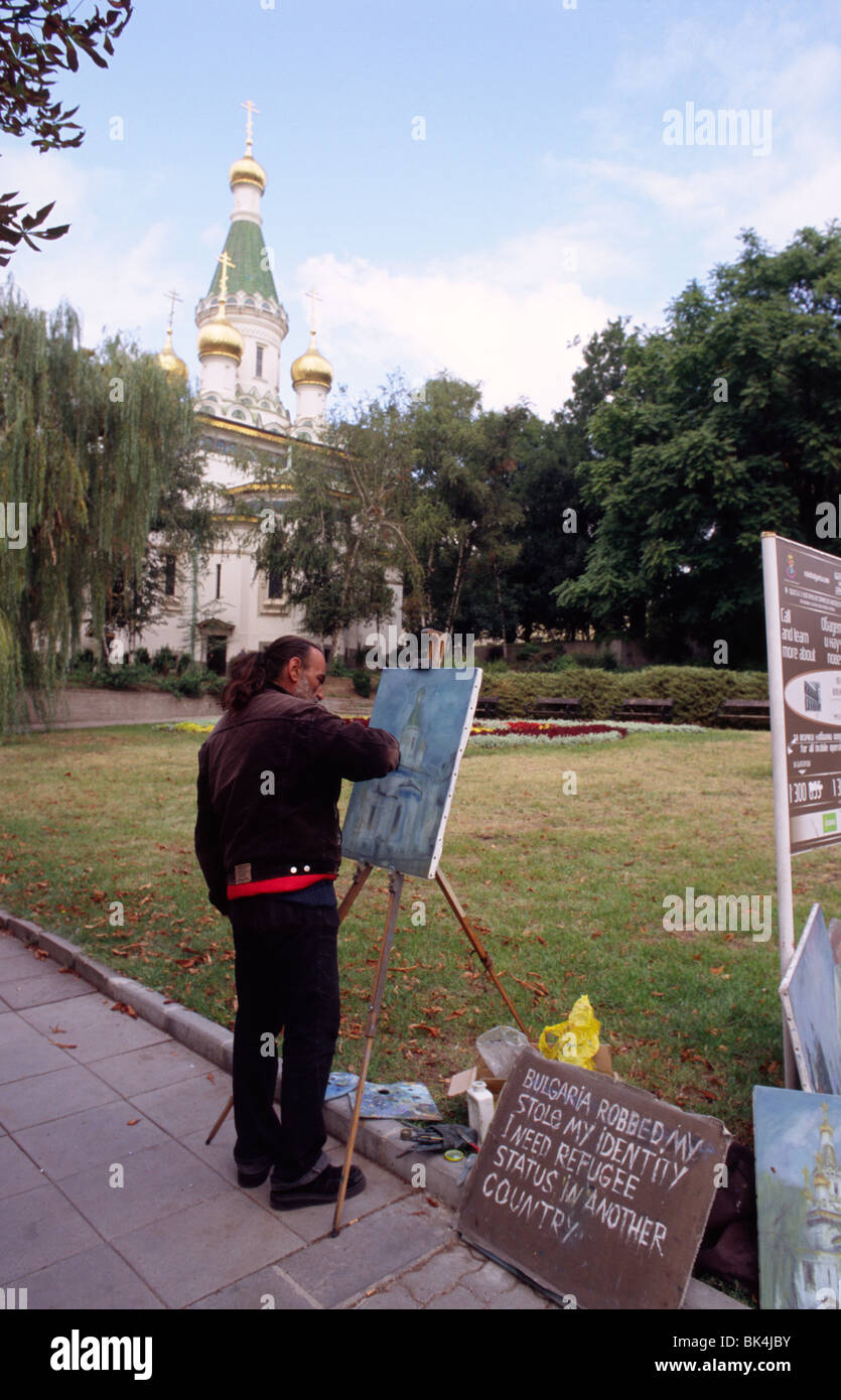 A street artist creates a painting depicting the Russian Church of Sofia, officially known as the Church of St Nicholas Stock Photo