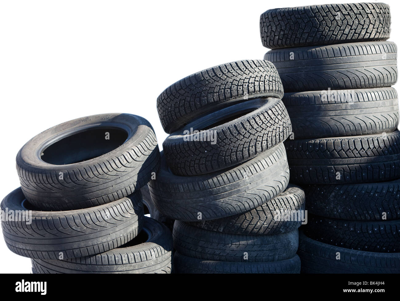 Piles of decommissioned car tyres - Stock Image