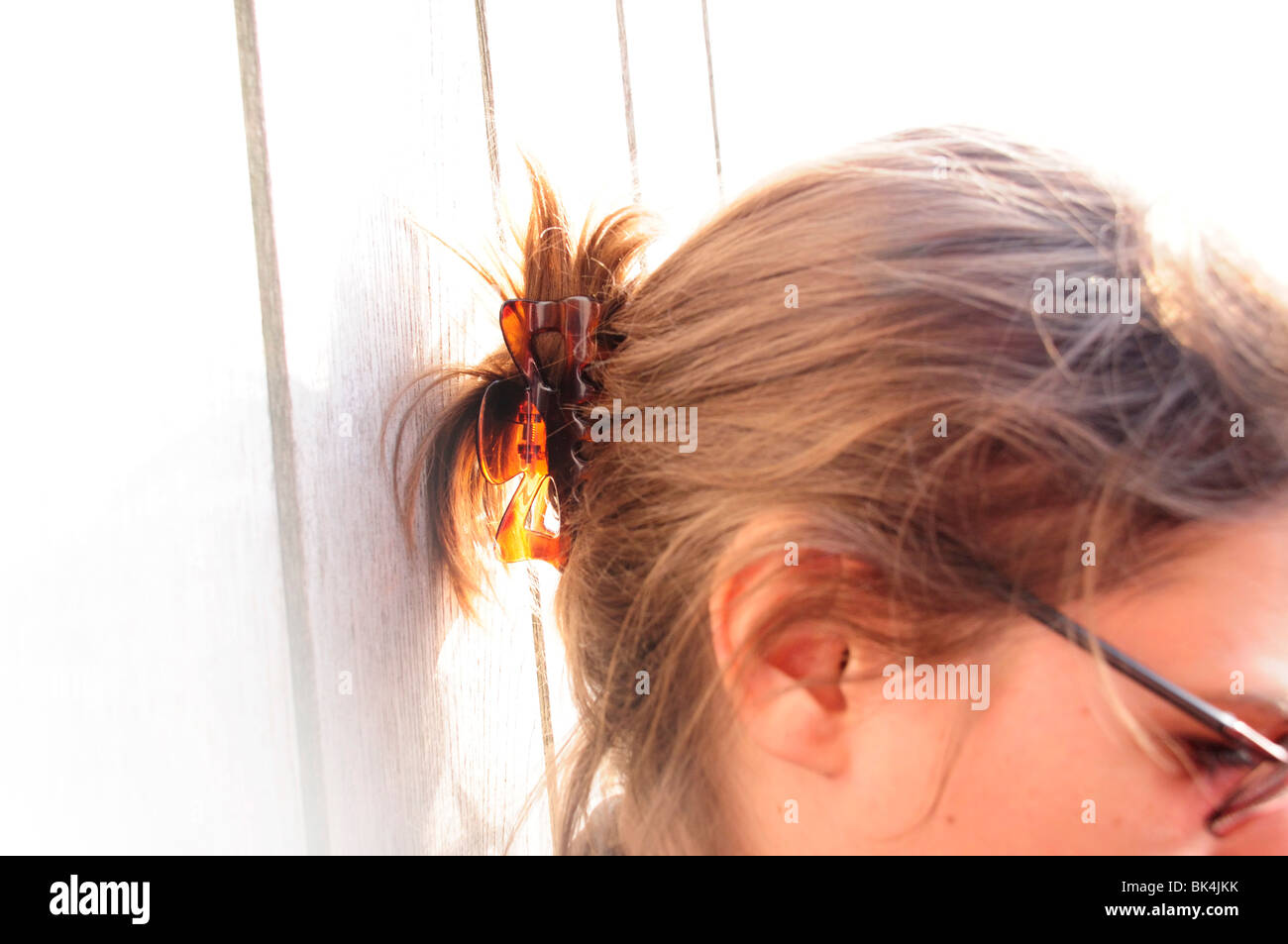 Profile of womans head and hair in clip - Stock Image