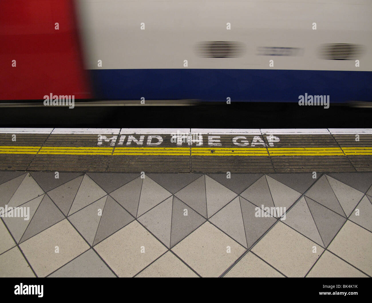 mind the gap written on platform at bank station on London underground - Stock Image