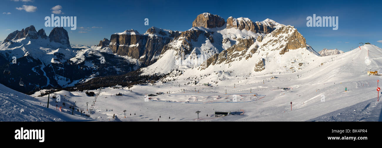 panoramic image of Dolomites mountains in winter, Italy, Belvedere ski area with view over the Gruppo Sella and - Stock Image