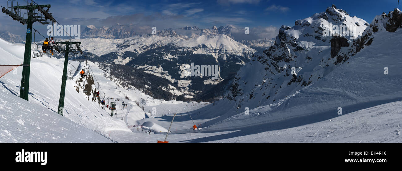 panoramic image of Dolomites mountains in winter, Italy, view from Passo Padon over N-E, towards Cortina D'Ampezzo - Stock Image