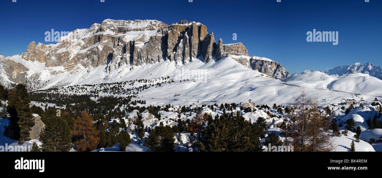 panoramic image of Dolomites mountains in winter, Italy, Gruppo Sella, Passo Sella, Marmolada in the background - Stock Image