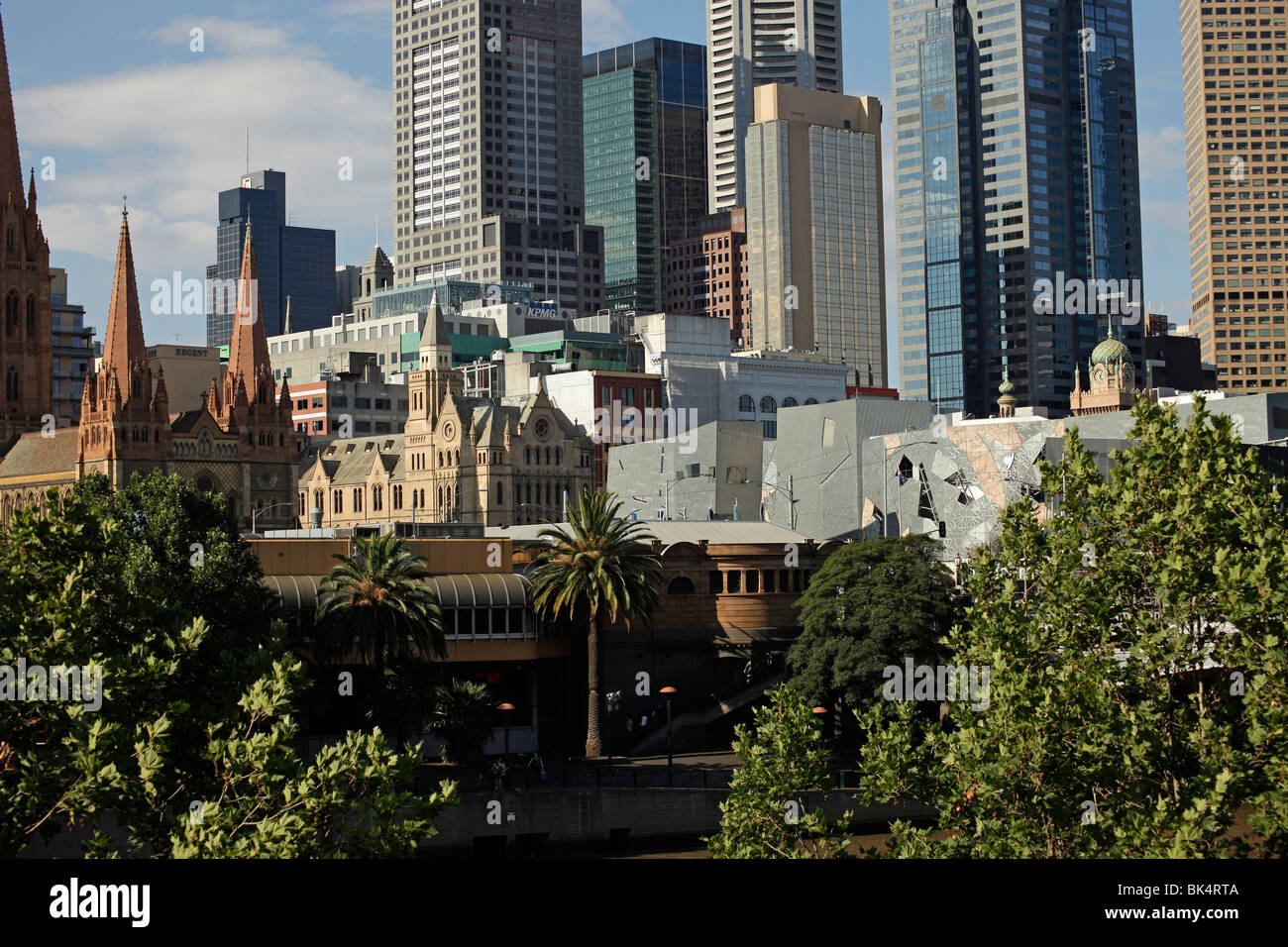 Melbourne Skyline with the towers of St Paul's Cathedral, Victoria, Australia - Stock Image
