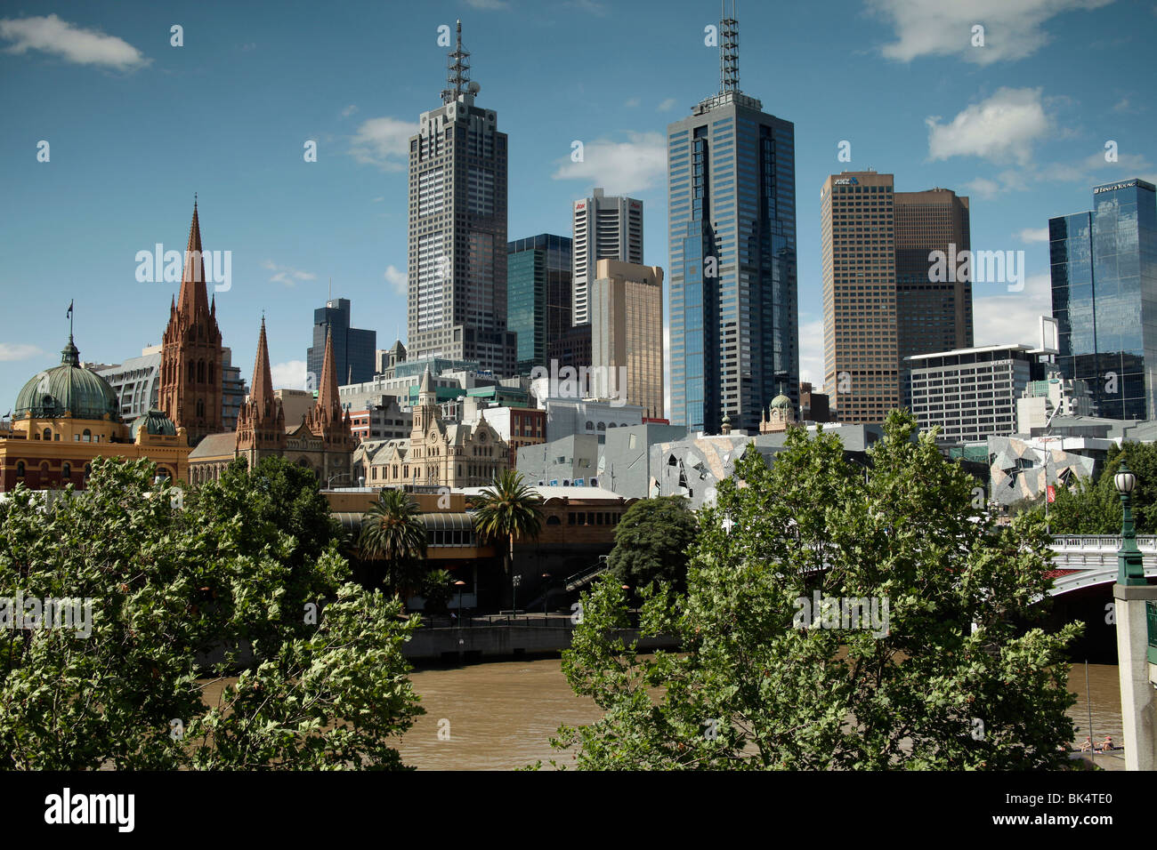 Melbourne Skyline with Flinders Street Station and the towers of St Paul's Cathedral, Victoria, Australia - Stock Image