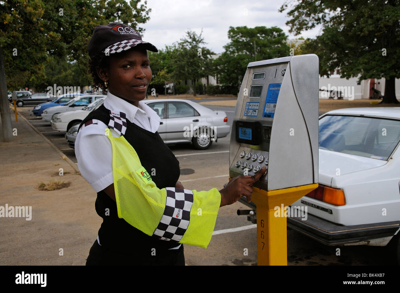 Portrait of parking meter attendant with the payment machine in Stellenbosch town centre western Cape South Africa - Stock Image