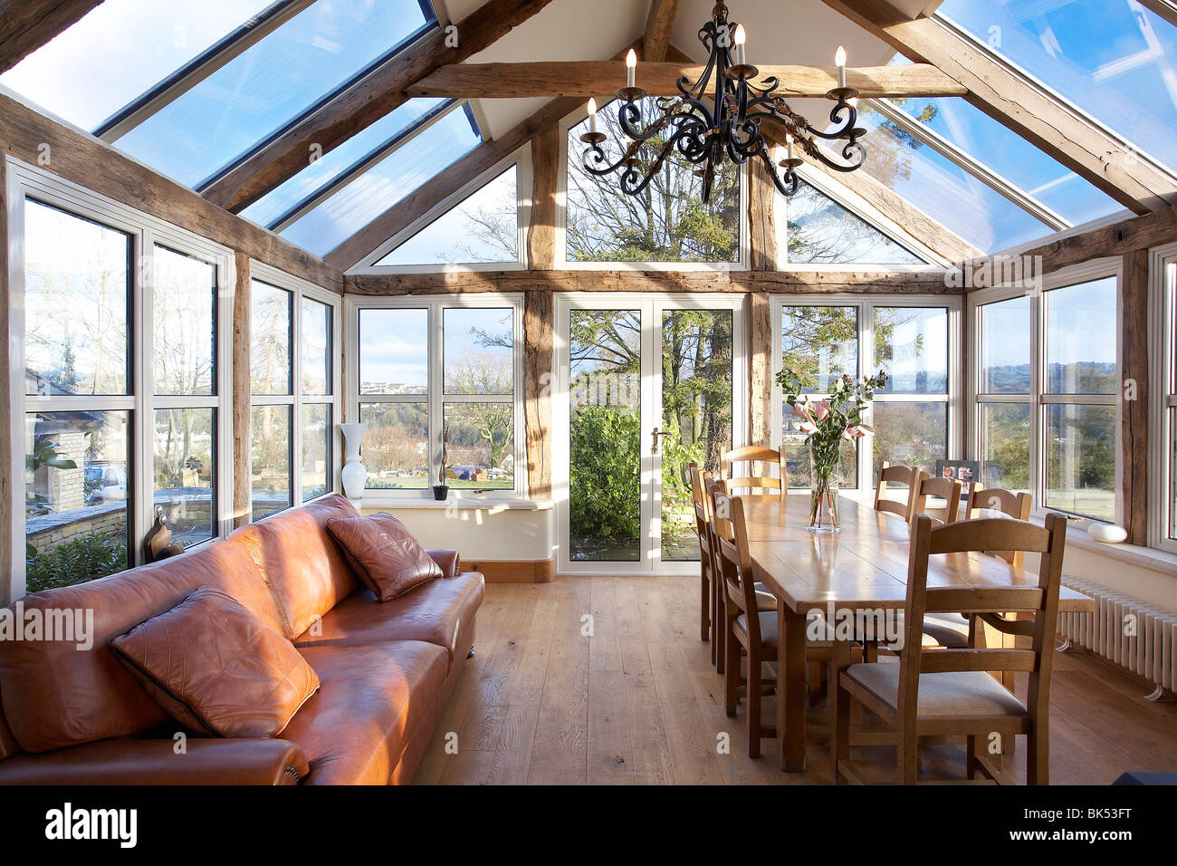 an orangery type conservatory interior of a house with oak frame