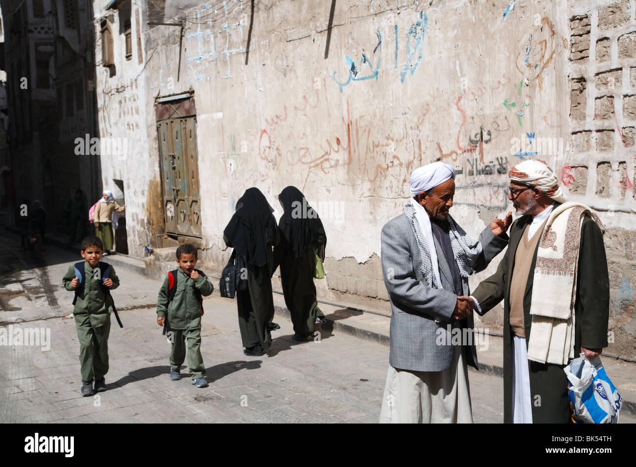 A street scene from the Old City of Sana'a, Yemen - Stock Image