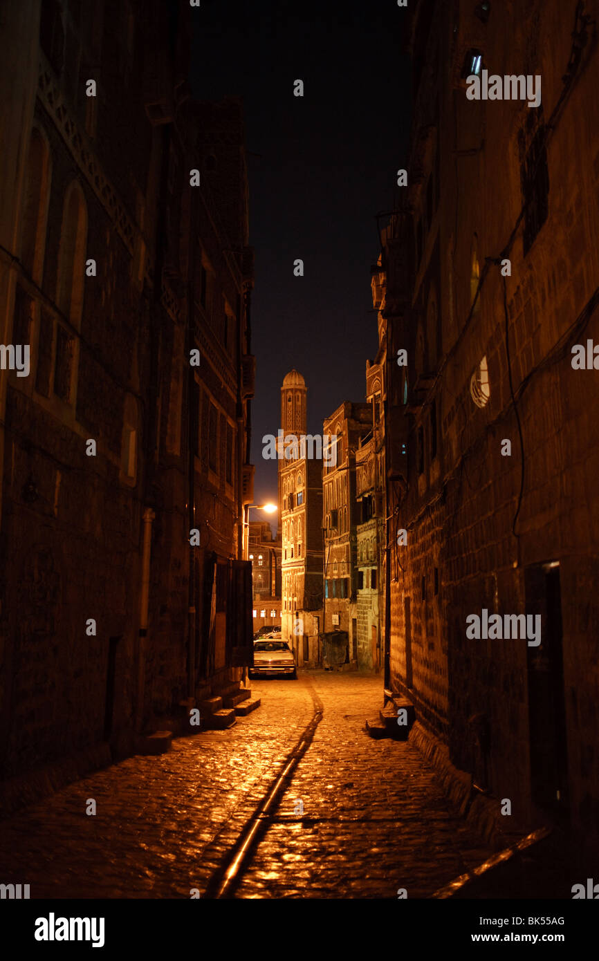 an old cobbled street at night in the Old City of Sana'a, Yemen - Stock Image