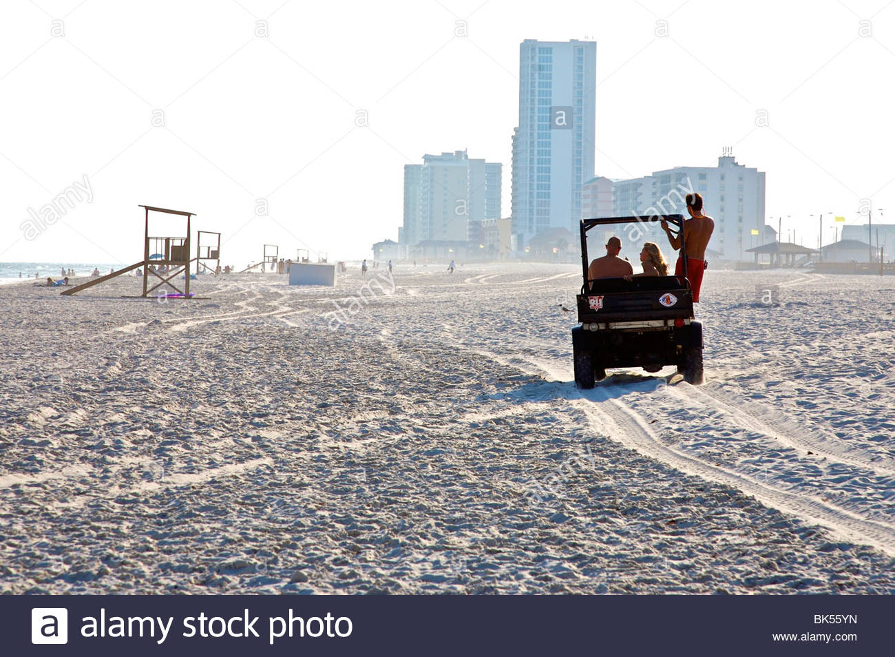 lifeguard beach patrol in motorized four wheel drive vehicle on gulf