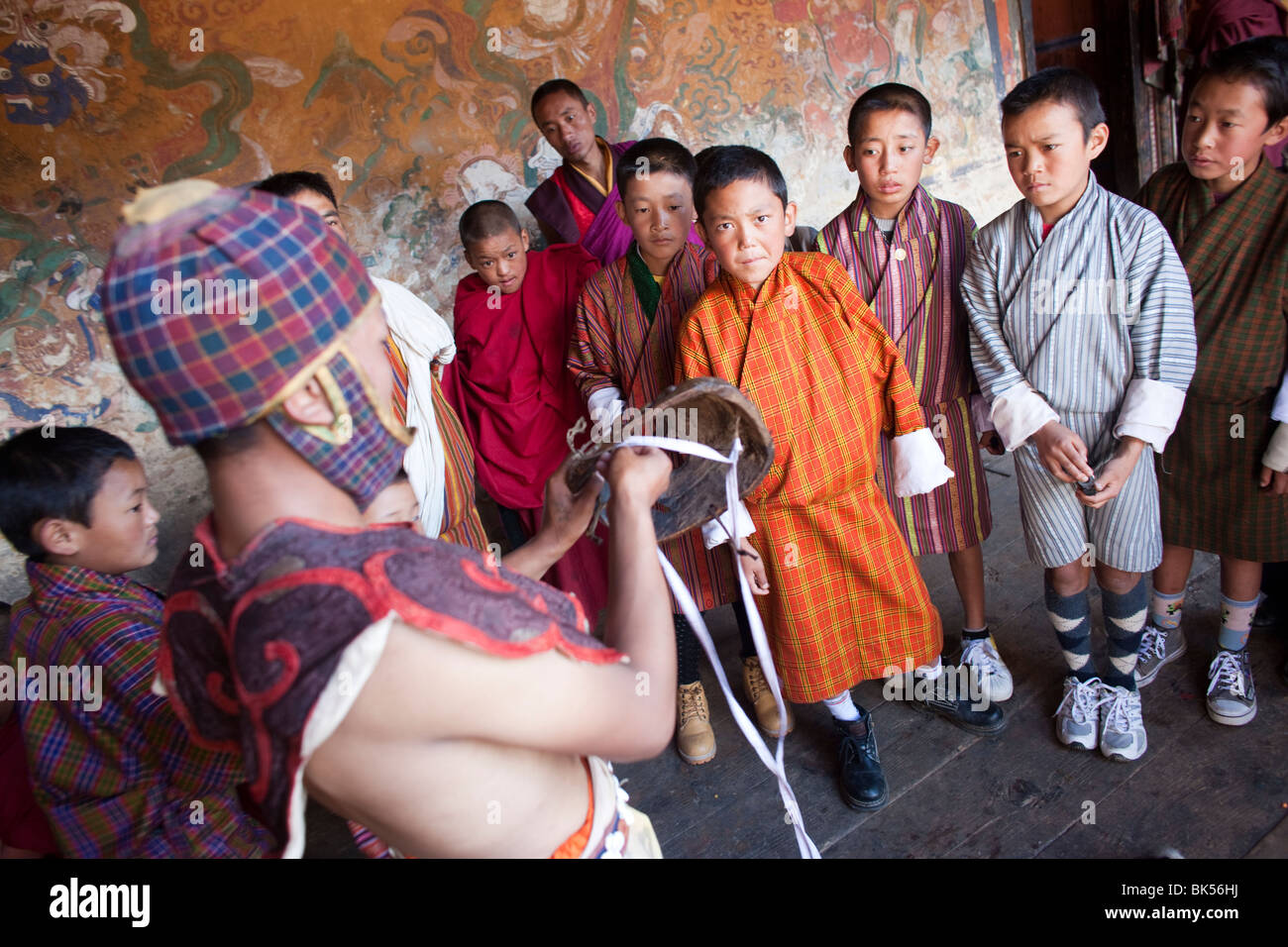 Buddhist monks celebrate at a traditional festival or Tsechu in Bhutan - Stock Image