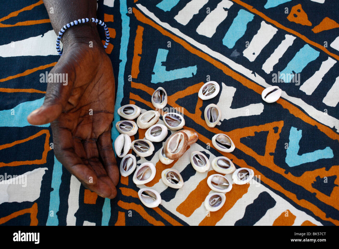 Fortune telling with cowrie shells, Saly, Thies, Senegal, West Africa, Africa - Stock Image