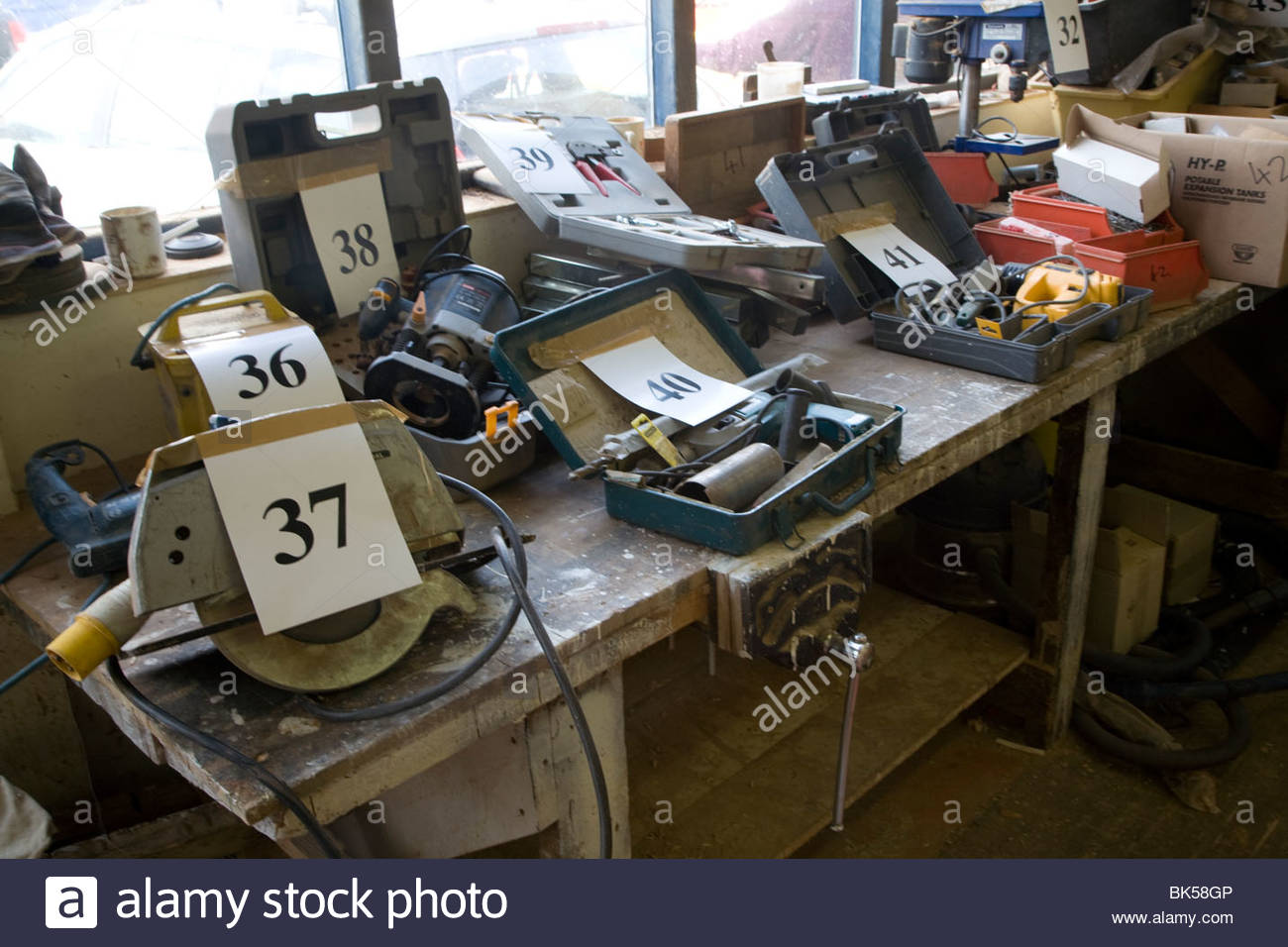 Auction items for sale at bankrupt building firm - Stock Image