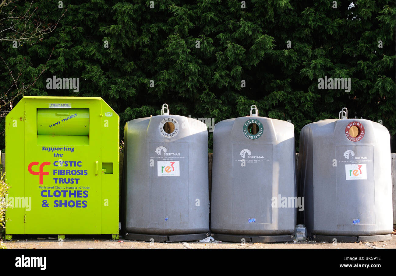 Communal rubbish  collection bins  (l to r )Old clothes and shoes, Bottles Banks for recycling  Clear, Green ,Brown - Stock Image