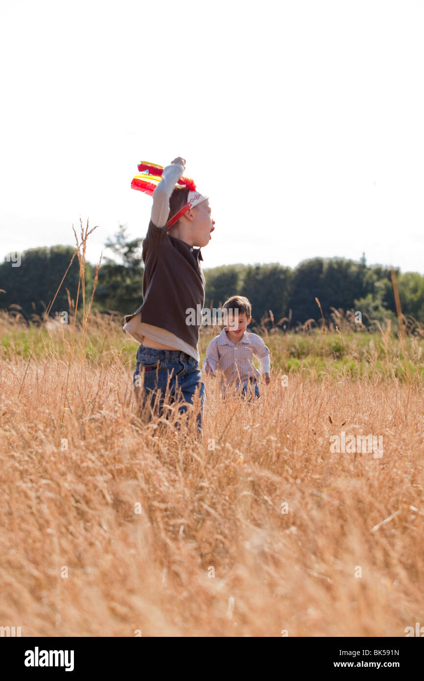 Young boys playing in field - Stock Image