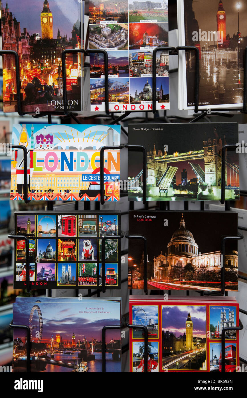 Postcards depicting classic sights for sale at a souvenir shop in central London. - Stock Image