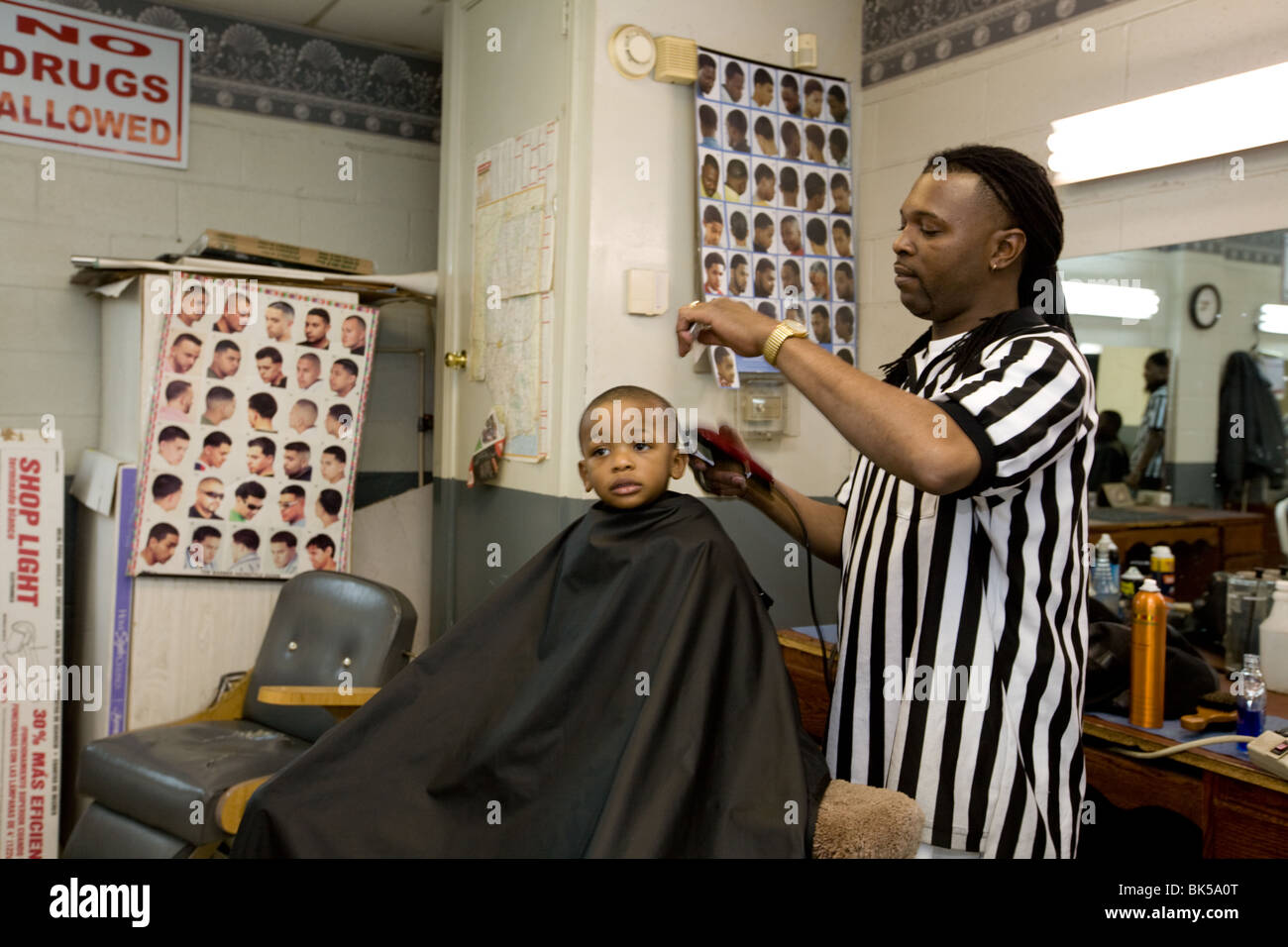 Child getting haircut in Clarksdale, Mississippi delta barber shop Stock Photo