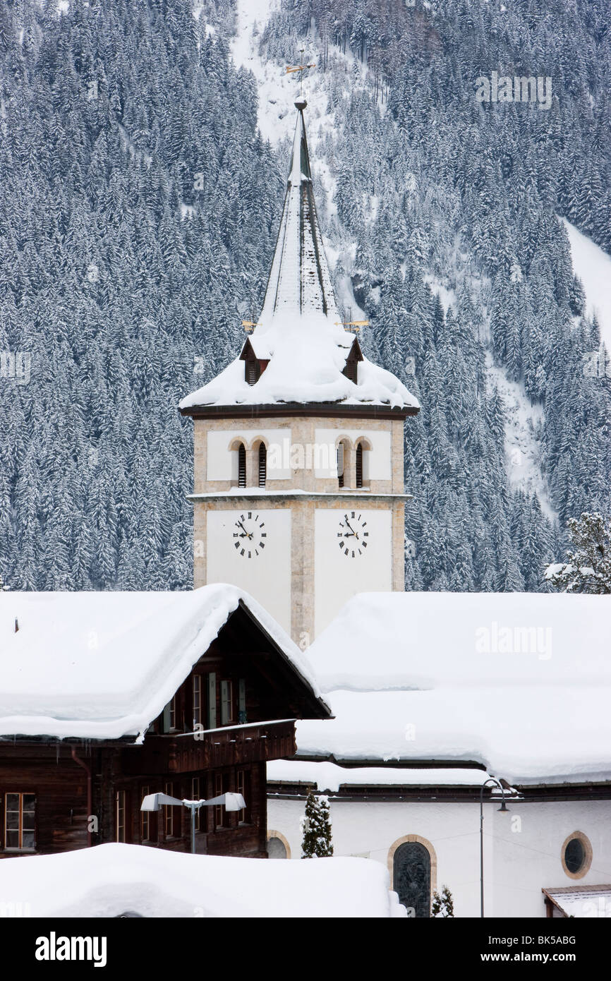 Grindelwald village church after a heavy fall of snow, Jungfrau region, Bernese Oberland, Swiss Alps, Switzerland, - Stock Image