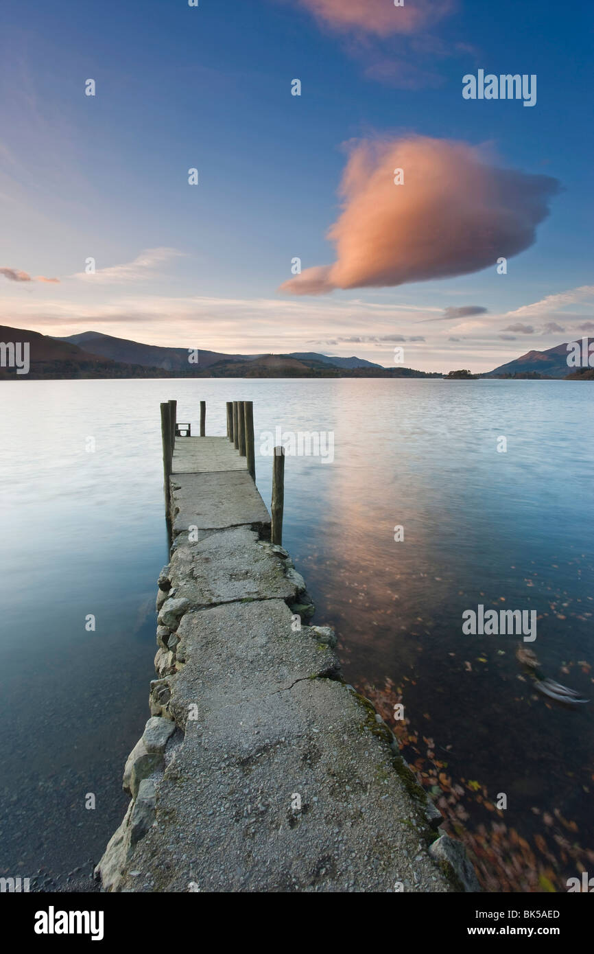 Cloud formation and wooden jetty at Barrow Bay landing, Derwent Water, Lake District National Park, Cumbria, England - Stock Image