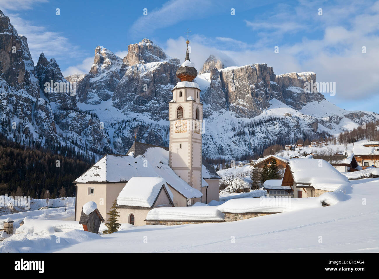 The church and village of Colfosco in Badia and Sella Massif range of mountains, South Tirol, Trentino-Alto Adige, - Stock Image