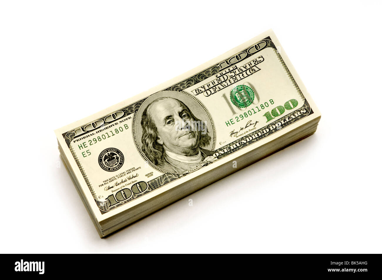 stack of American Dollars, money, currency on white background - Stock Image
