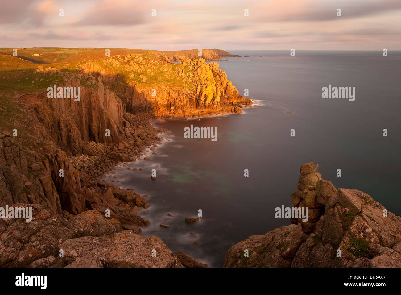 Towering cliffs of Lands End, Cornwall, England, United Kingdom, Europe - Stock Image