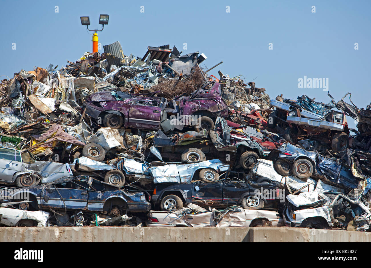 Detroit, Michigan - Junk cars crushed and ready for recycling at a scrap yard. Stock Photo