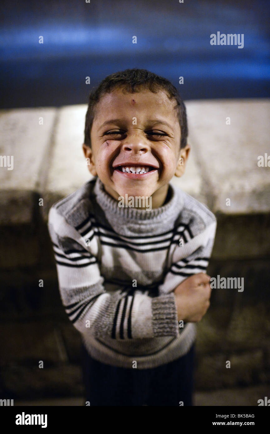 a portrait of a smiling little boy in the Old City of Sana'a, Yemen. - Stock Image