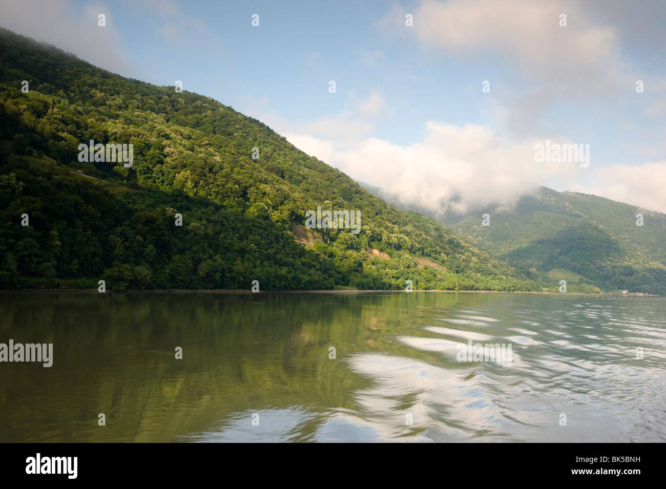 A view of the Kazan Gorge from a ship cruising on the Danube River between Serbia and Romania, Europe - Stock Image