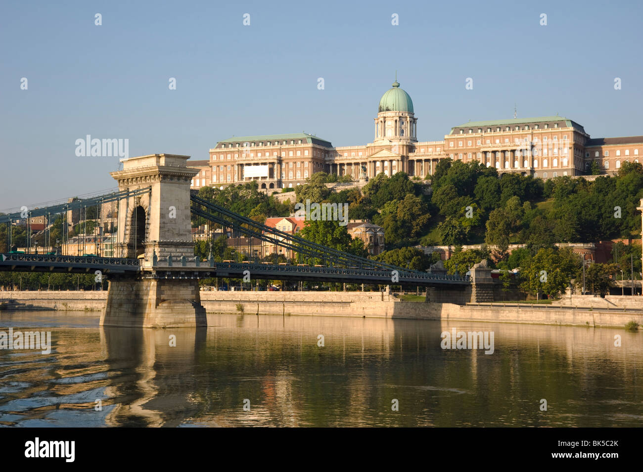 The Chain Bridge over the Danube River and Castle Hill seen from a boat, Budapest, Hungary, Europe - Stock Image