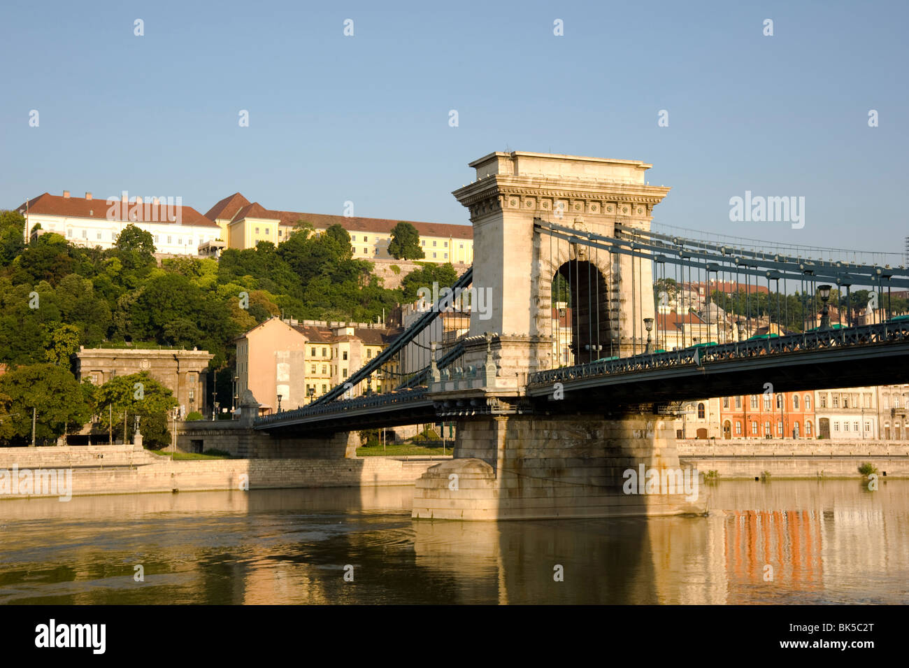 Early morning sailing under the Chain Bridge over the Danube River, Budapest, Hungary, Europe - Stock Image