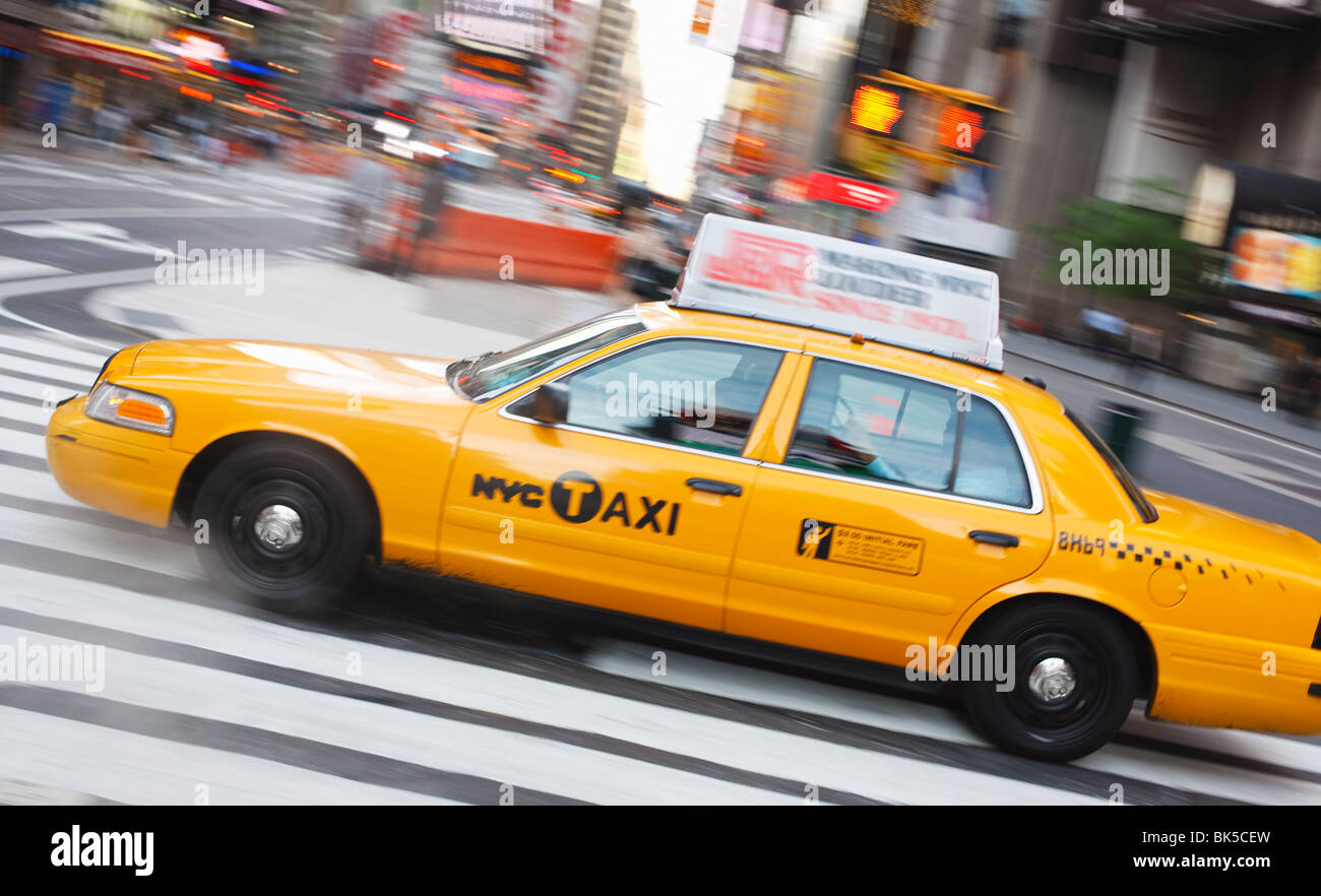 Taxi in Times Square, Manhattan, New York City, New York, United States of America, North America - Stock Image