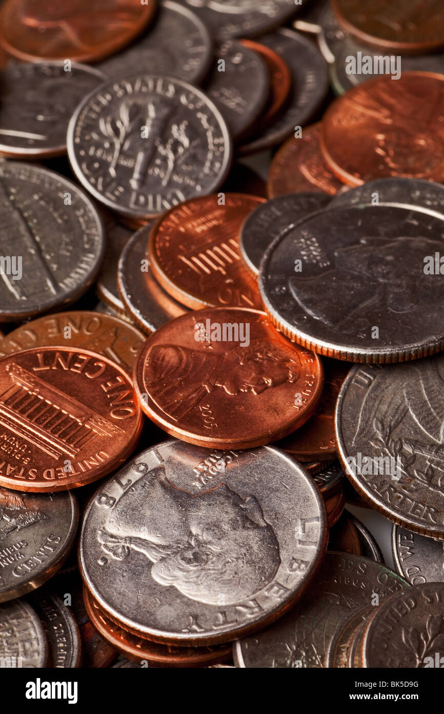 loose change background with pennies, nickels, dimes, and quarters - Stock Image