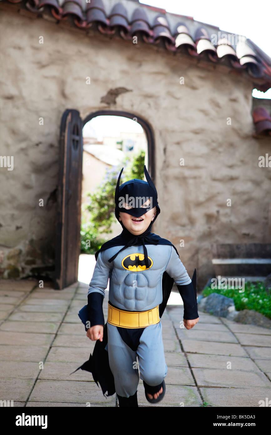 Boy in batman costume - Stock Image