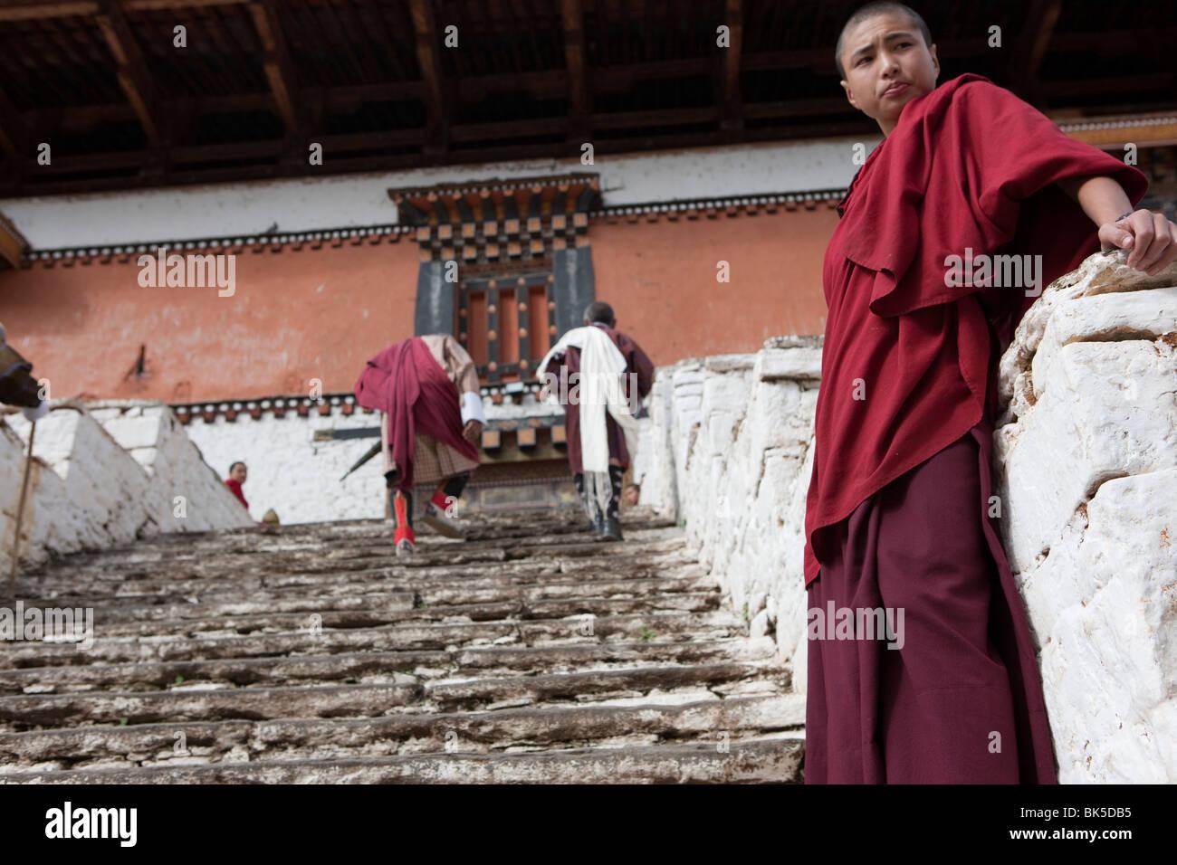 Monks in a monastery in Bhutan - Stock Image