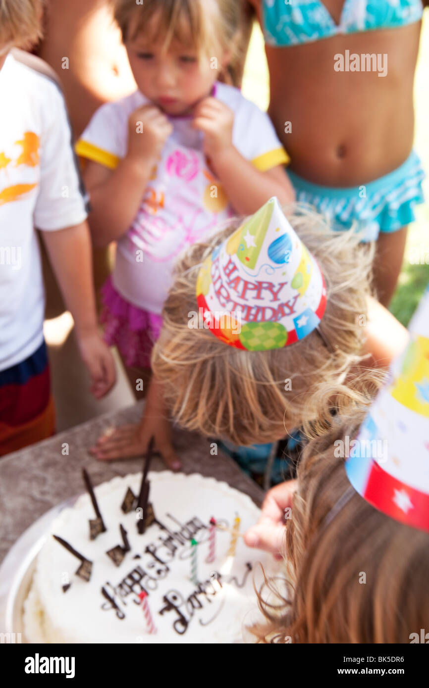 Blowing out the candles of a birthday cake - Stock Image