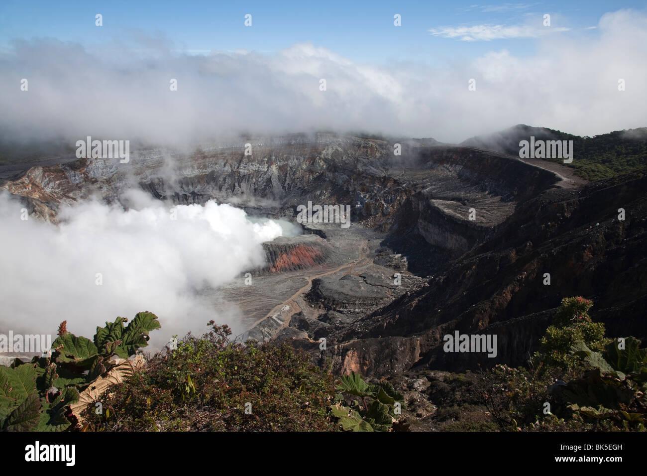 Active volcano smoke erupting from volcano crater - Stock Image