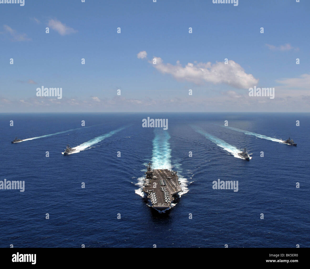 The aircraft carrier USS Abraham Lincoln (CVN-72) leads a formation of ships, Indian Ocean - Stock Image