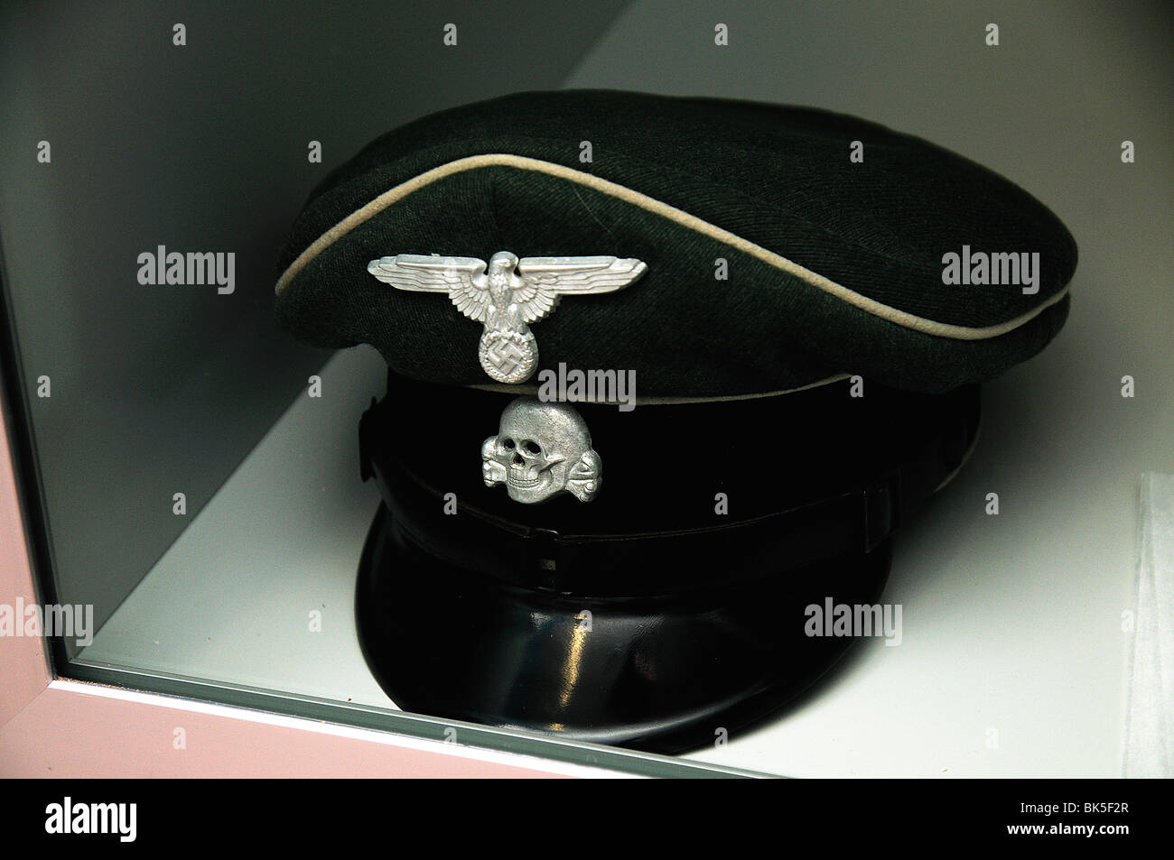 Ss cap with nazi swastika and skull emblem stock image