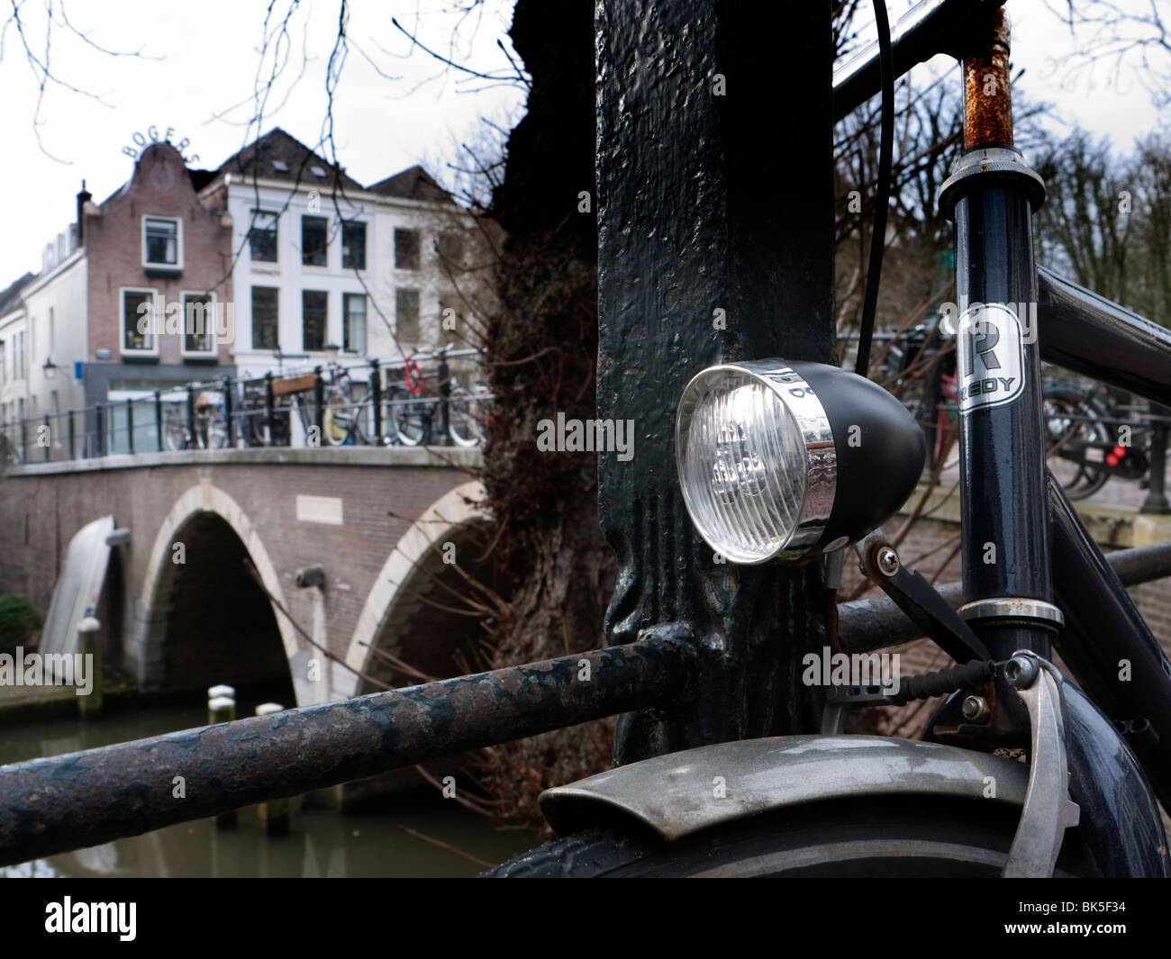 Detail of parked bicycle on street beside Oude Gracht or Old Canal in Utrecht The Netherlands - Stock Image