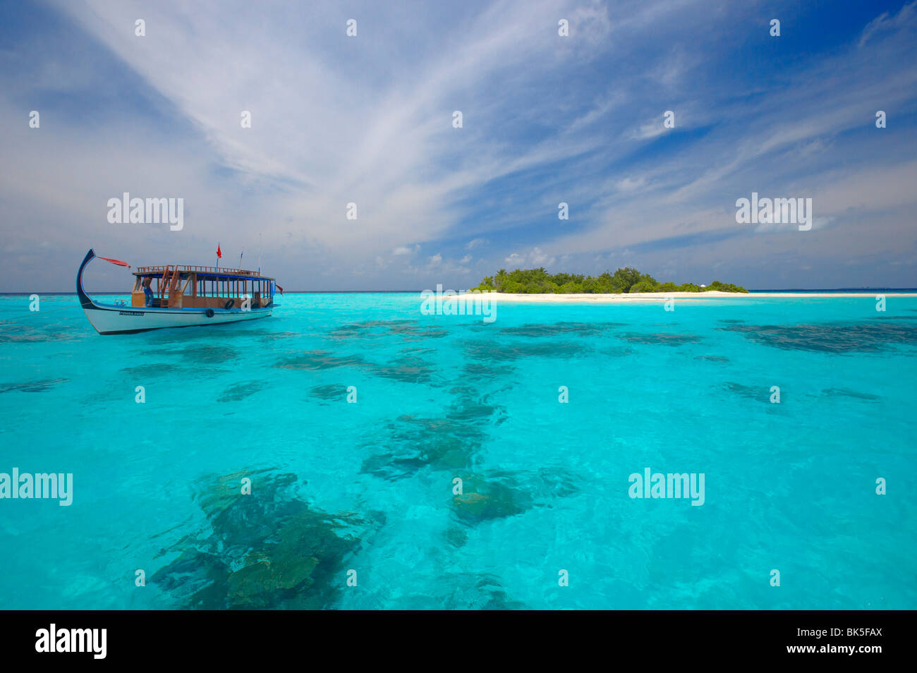 Dhoni and deserted island, Maldives, Indian Ocean, Asia - Stock Image
