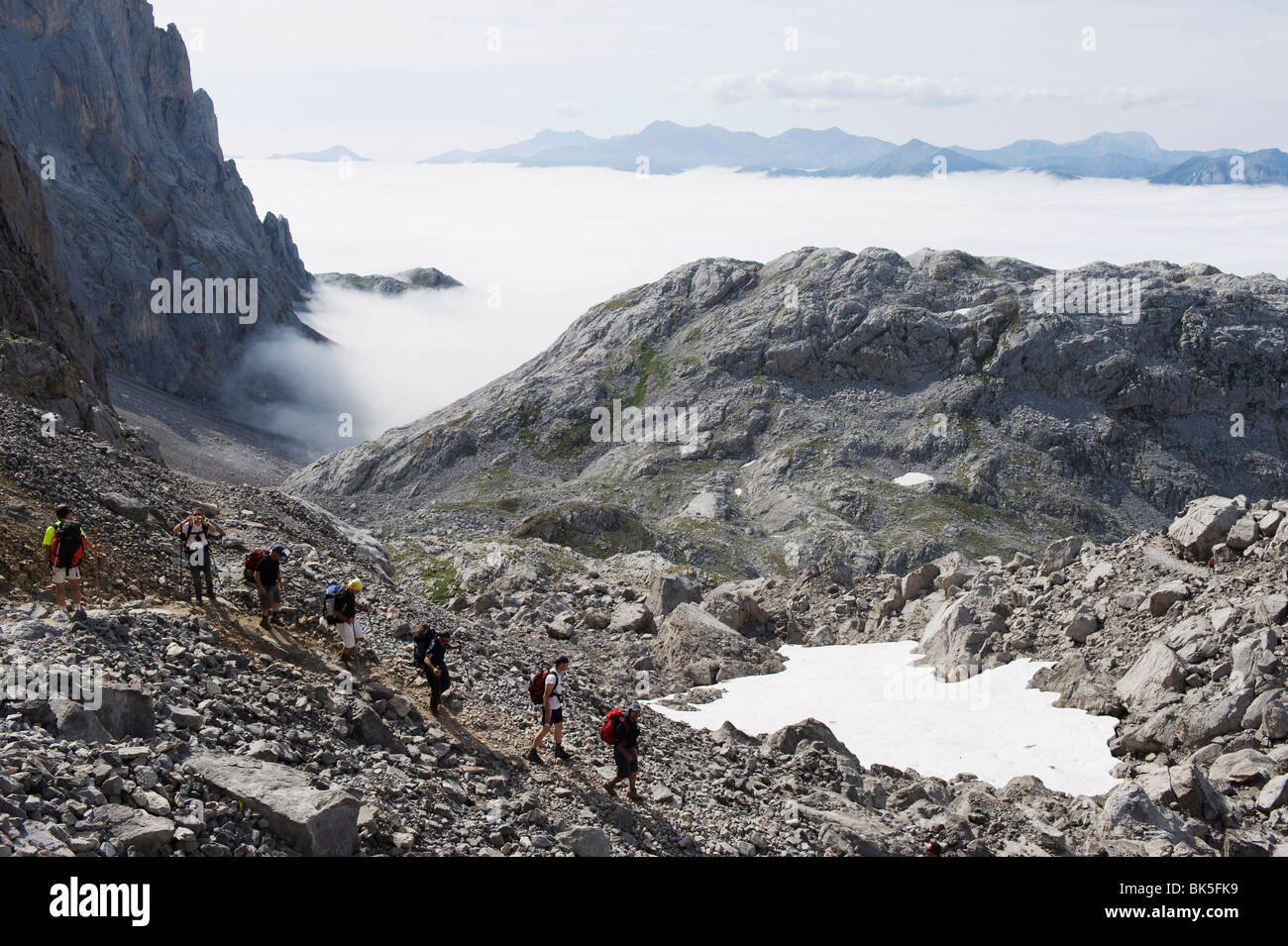 Hikers in the Picos de Europa National Park, shared by the provinces of Asturias, Cantabria and Leon, Spain, Europe - Stock Image