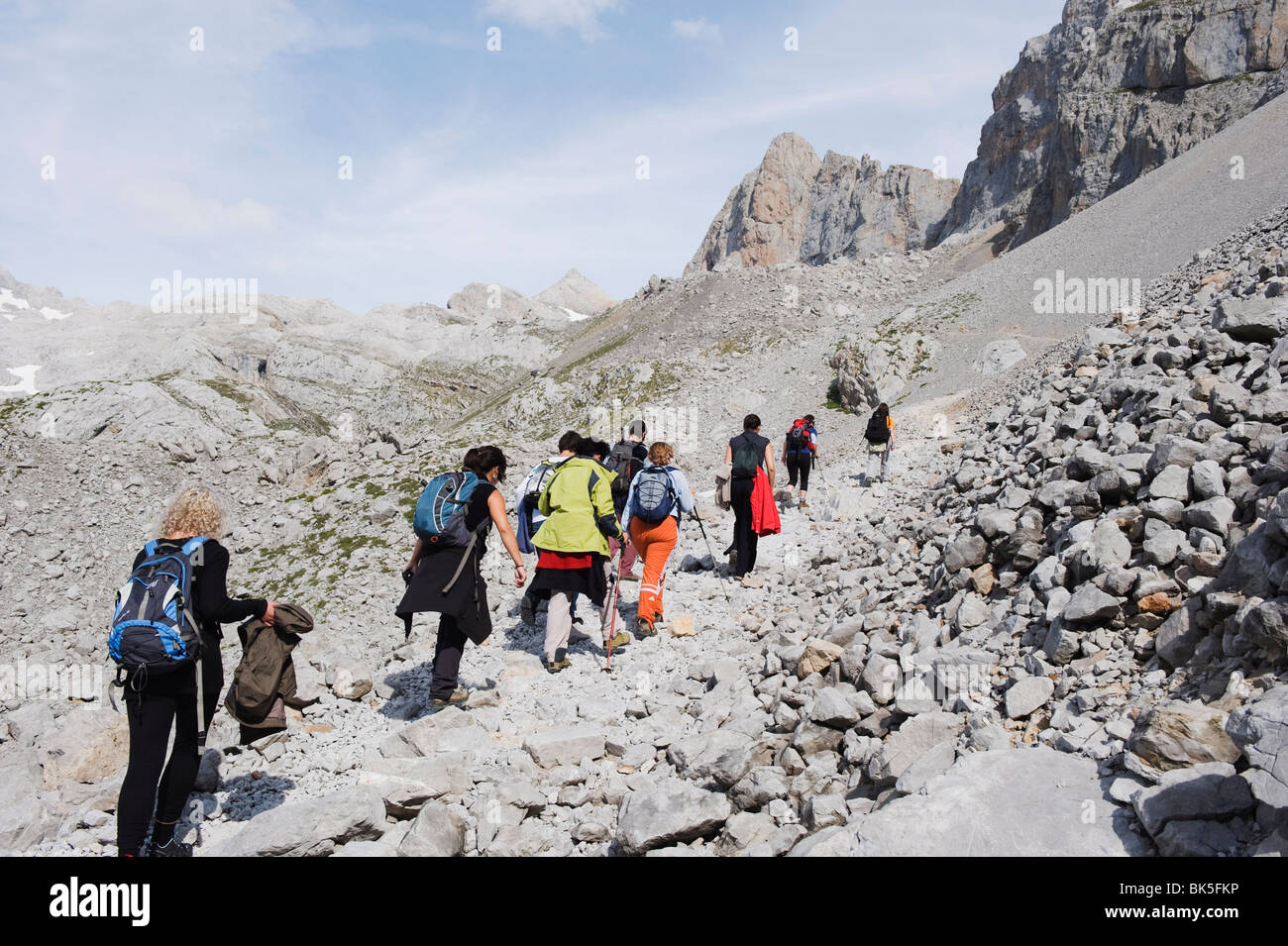 Hikers in Picos de Europa National Park, shared by the provinces of Asturias, Cantabria and Leon, Spain, Europe - Stock Image