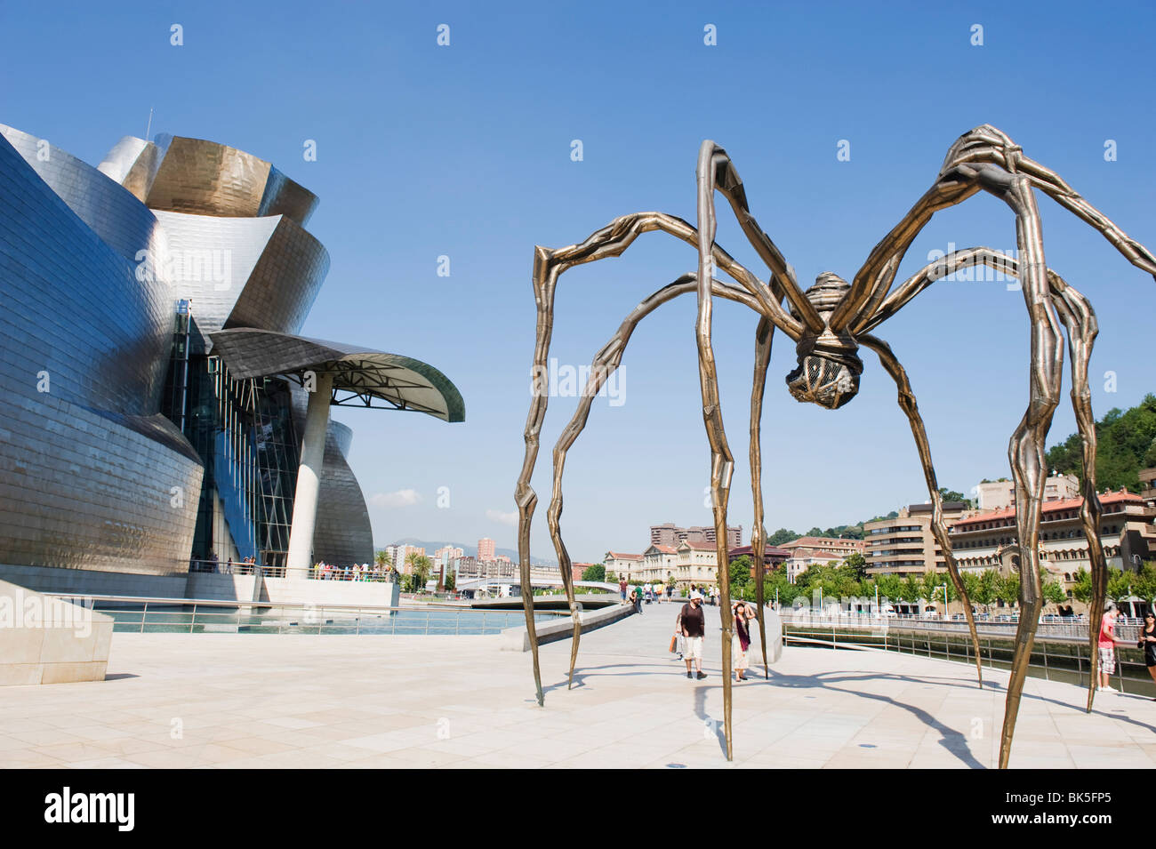 The Guggenheim, designed by architect Frank Gehry, and giant spider sculpture by Louise Bourgeois, Bilbao, Spain - Stock Image