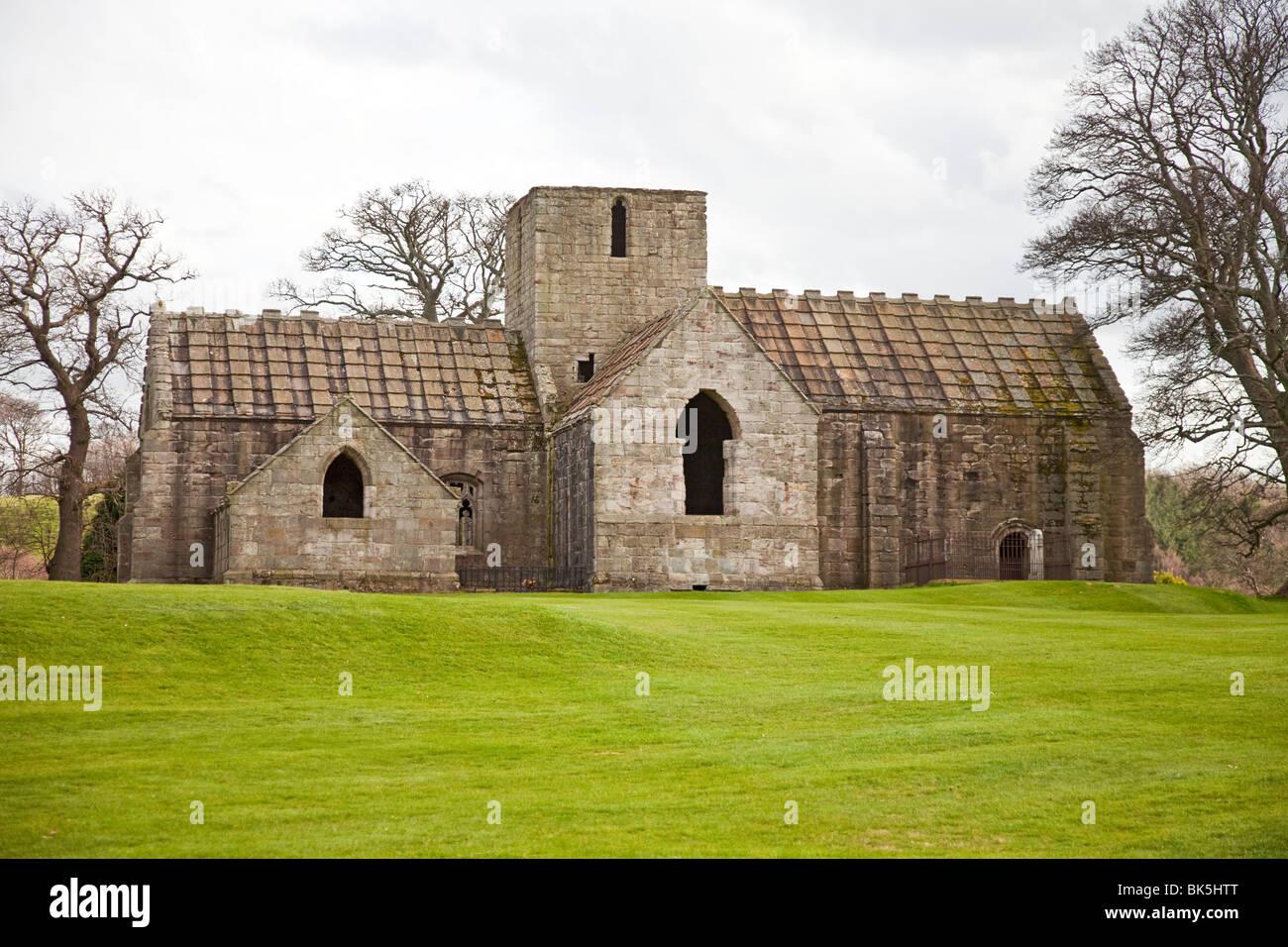 Dunglass Collegiate Church, a ruined but well-preserved 15th century pink sandstone church near Cockburnspath, Berwickshire, - Stock Image