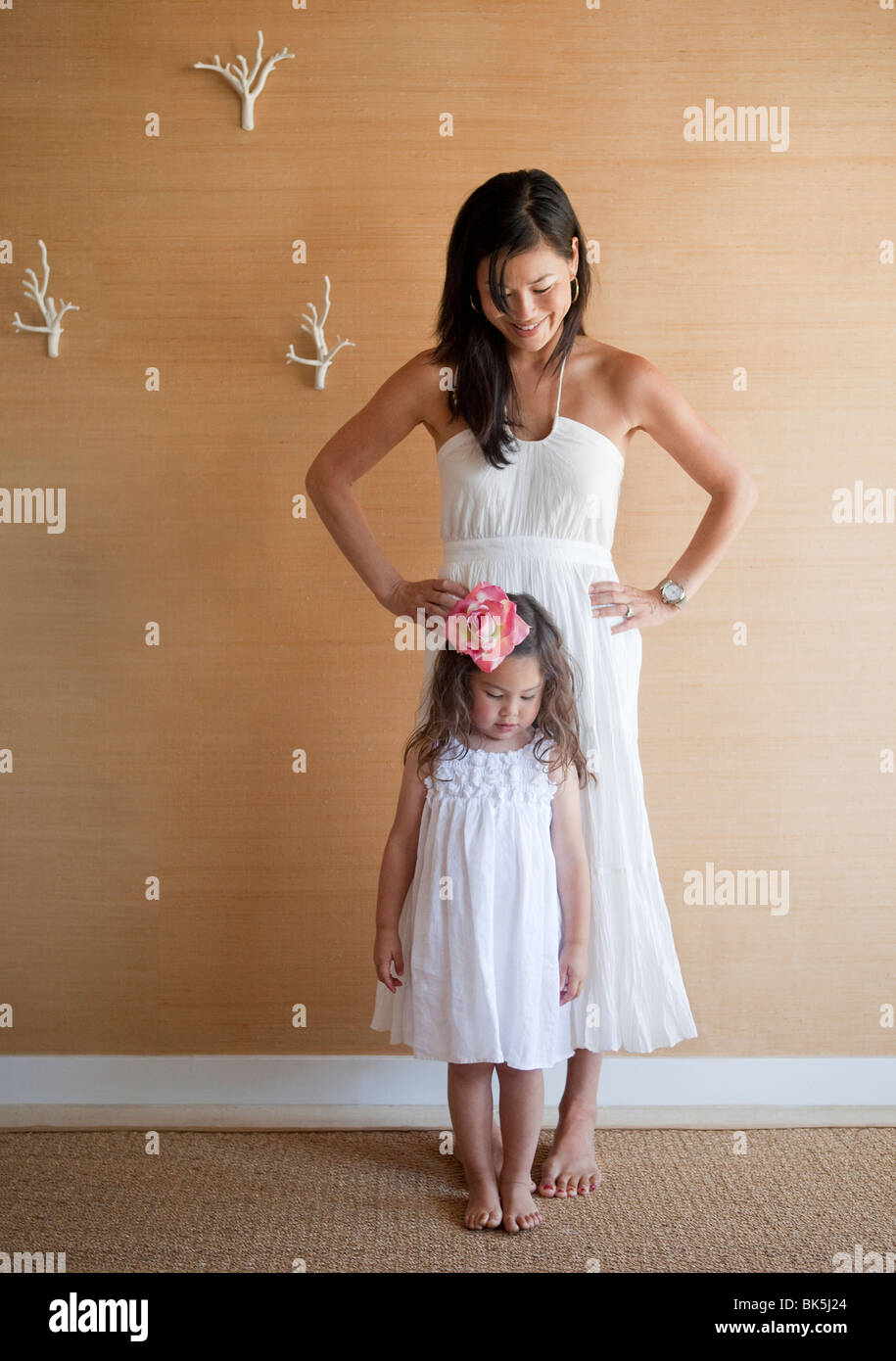 Mother and daughter in matching sundresses - Stock Image
